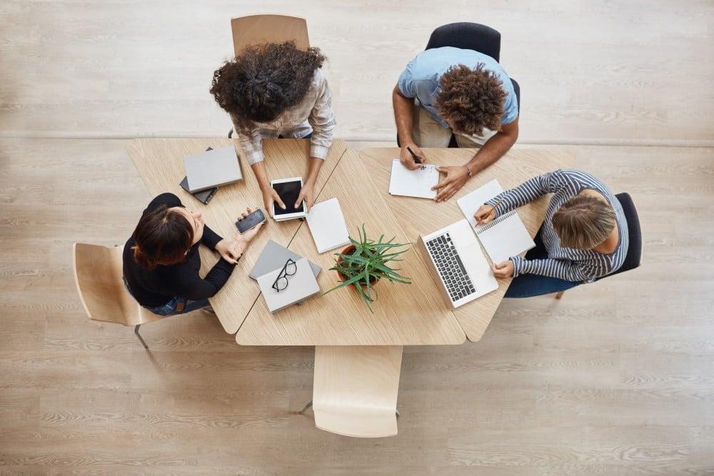 employees having meeting in the meeting room